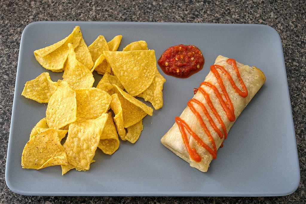 Siriracha burrito and chips, with garlic chili sauce.