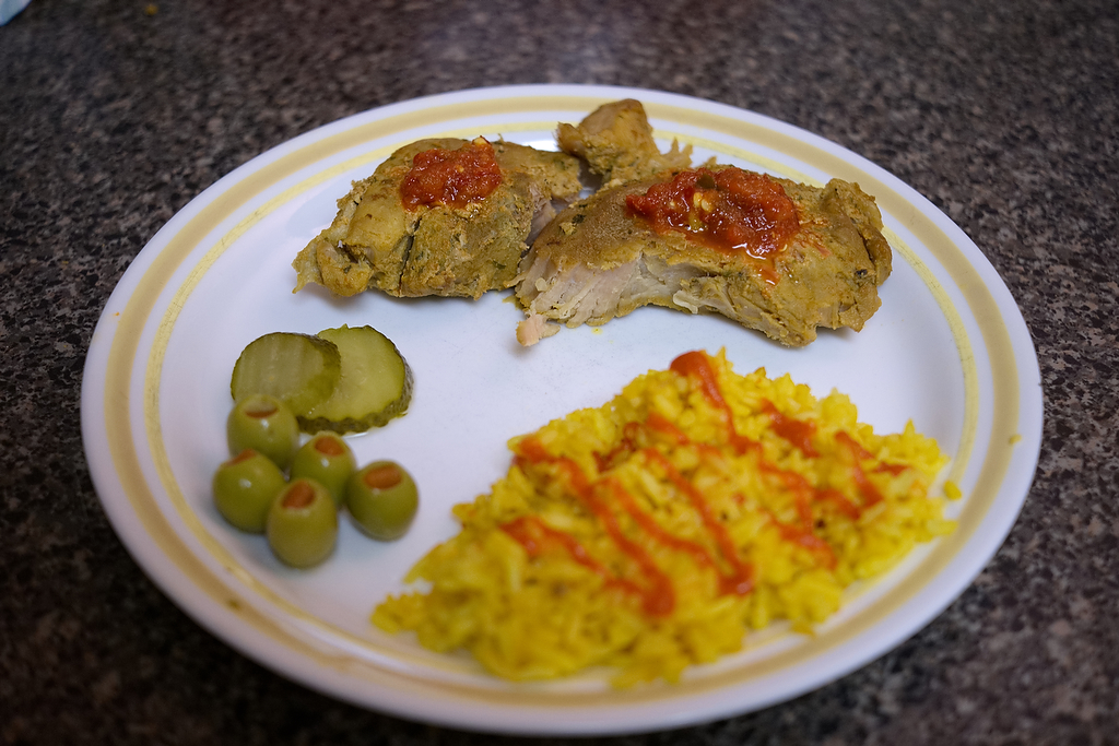 Pork chops with garlic chili sauce, and saffron rice and sriracha.